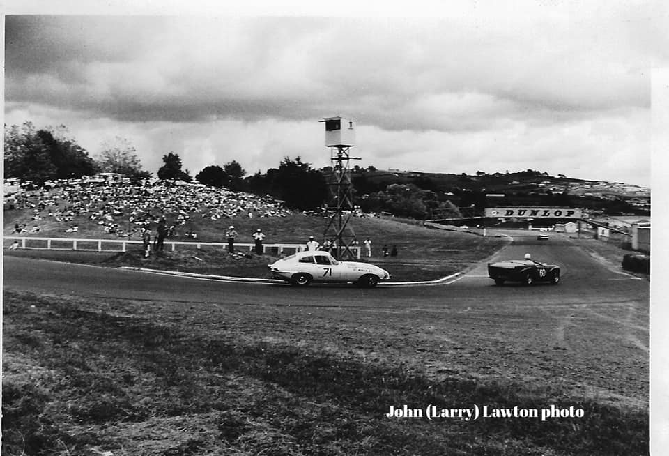 Name:  Pukekohe 1965 #65 Trevor Sheffield leads the E-type of G Bremer elbow 1965 J L Lawton .jpg
