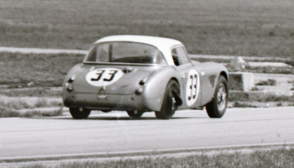 Name:  AH 3000 #366 Sebring 1964 Cars #33 and #34 . car #33 shedding tyre K Stelk archives .jpg