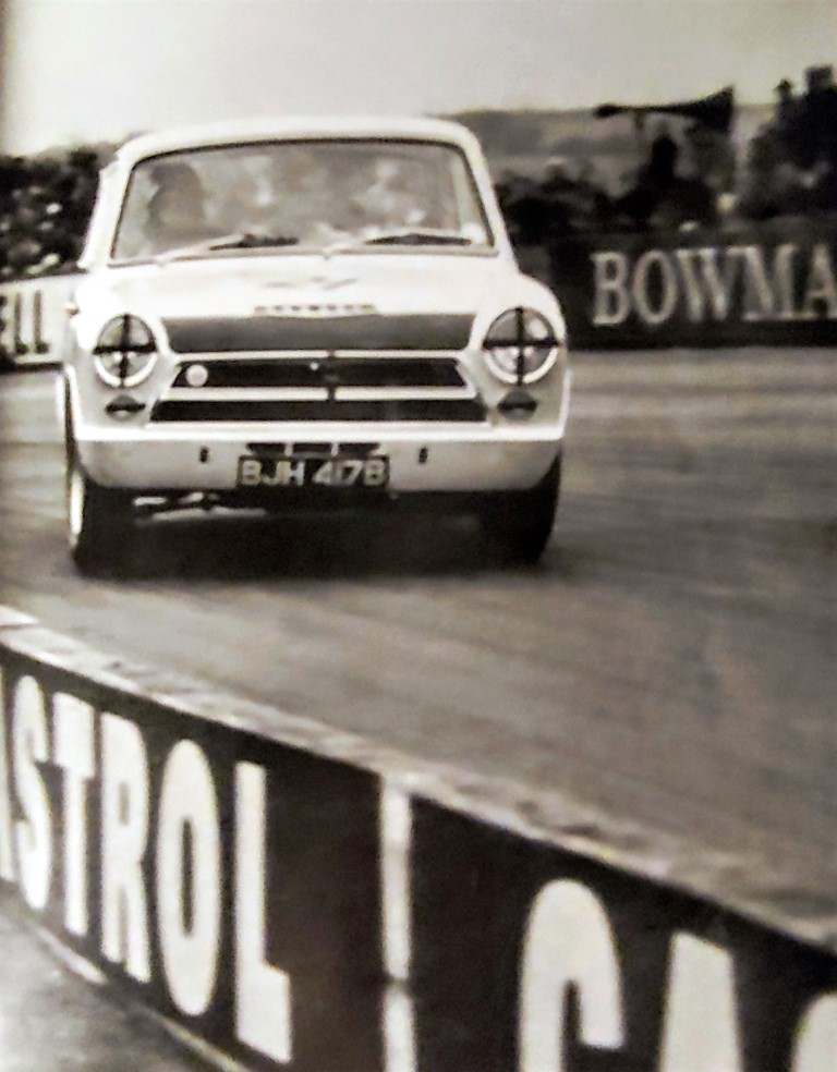Name:  Jimmy in Lotus Cortina. 1964...jpg