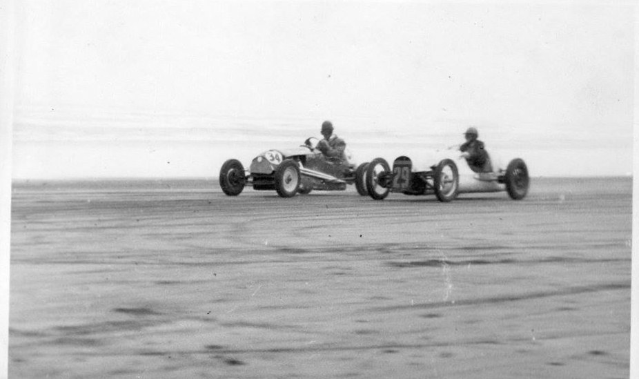 Name:  NSCC 1955 #235 NSCC Muriwai beach, June 1955. Herb Gilroy A40 special Don Tilsley Singford Speci.jpg Views: 34 Size:  82.1 KB