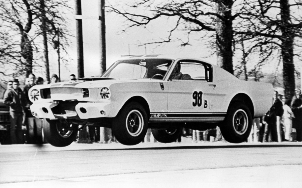 Name:  1965 ken-miles-in-the-1965-ford-shelby-gt350-competition-with-chassis-no-5r002-at-green-valley-r.jpg