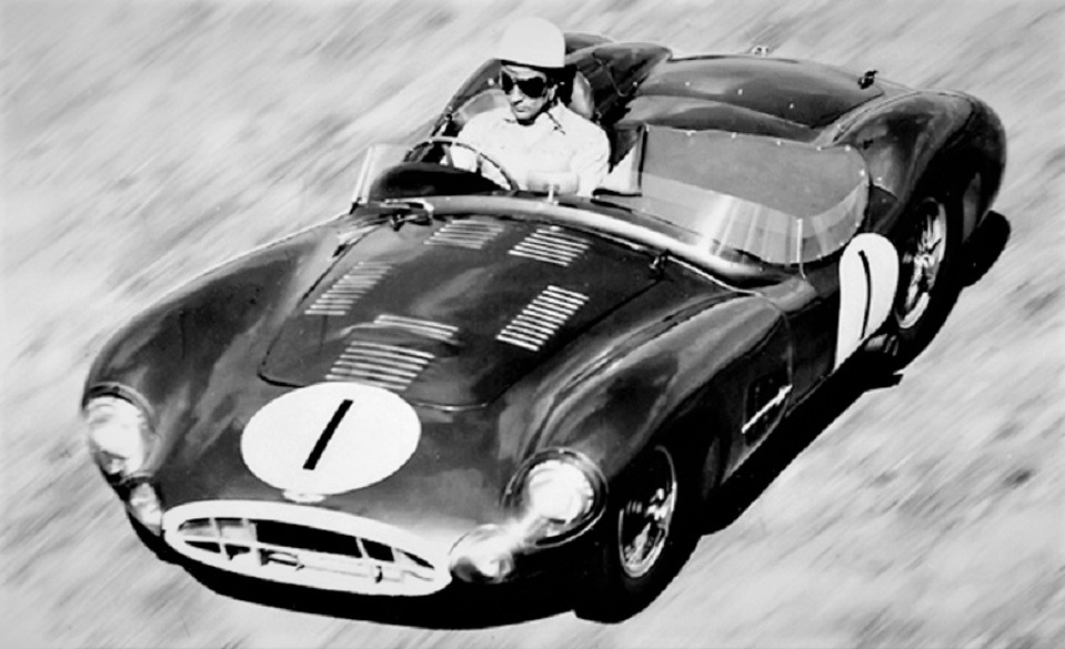 Name:  1957.  Stirling Moss driving the Aston Martin DBR2. He was unhappy with the performance of this .jpg