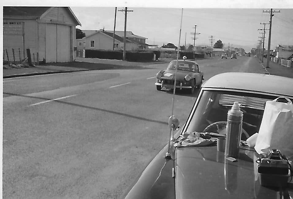 Name:  NSCC 1965 #34 Castrol Rally 1965 Control in  Ngatea.  John McNicoll arriving John L Lawton .jpg Views: 170 Size:  61.8 KB