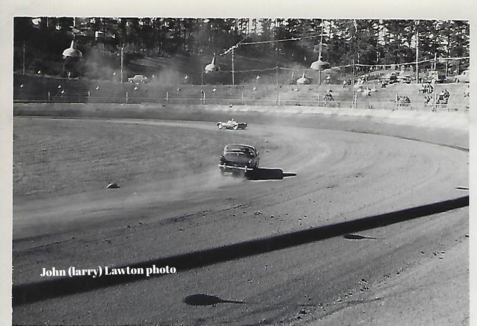 Name:  NSCC #326 1965 8 May Roger Smith in the Daimler Dart chasing Jamie Aislebie J L Lawton .jpg Views: 302 Size:  78.0 KB