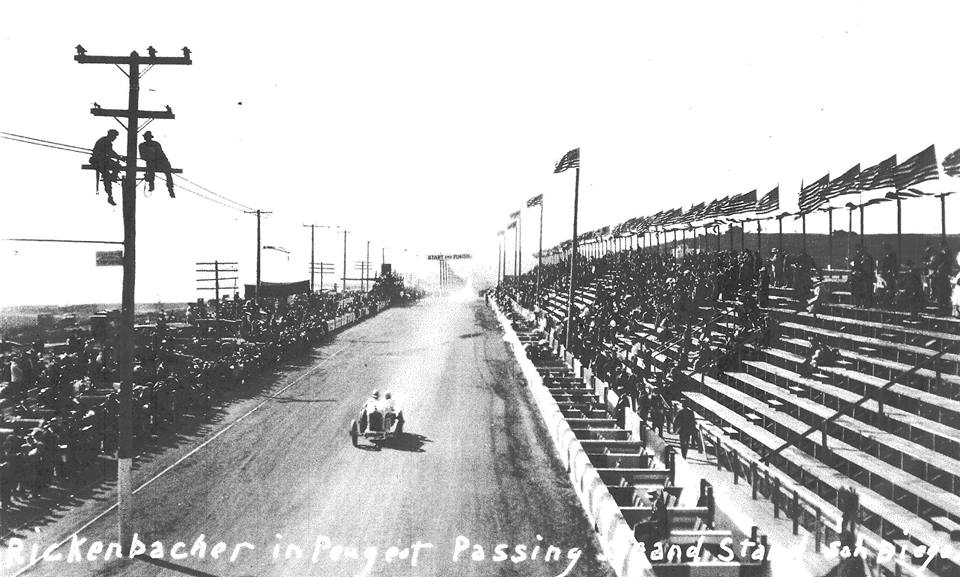 Name:  1915. Eddie Rickenbacher driving past the grandstand..jpg