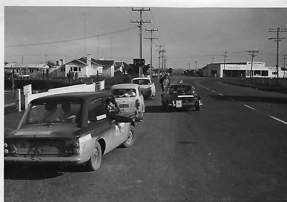 Name:  NSCC 1965 #3 Castrol Rally 1965 Wayne Jones  Control in  Ngatea. In front Gerry Smaller, John Mc.jpg Views: 174 Size:  59.6 KB